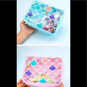 Cute makeup bags in blue or pink .